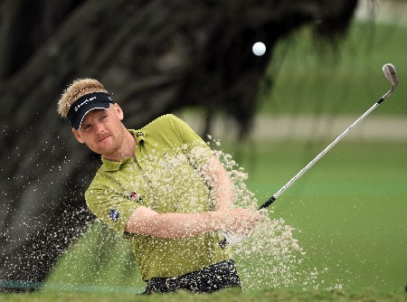 MIAMI - MARCH 19:  Soren Kjeldsen of Denmark plays from a practice bunker during practice for the 2008 World Golf Championships CA Championship at the Doral Golf Resort & Spa, on March 19, 2008 in Miami, Florida.  (Photo by David Cannon/Getty Images)