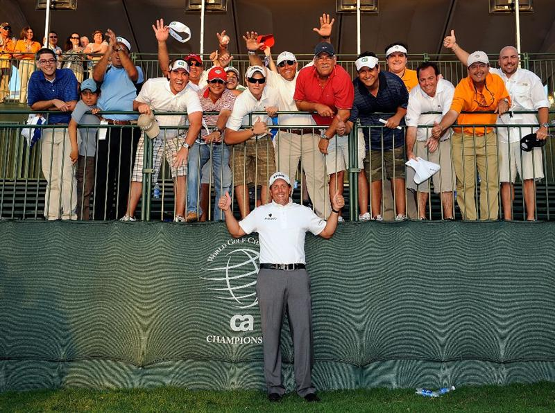 DORAL, FL - MARCH 15:  Phil Mickelson celebrates with a group of fans after winning the World Golf Championships-CA Championship at the Doral Golf Resort & Spa on March 15, 2009 in Doral, Florida.  (Photo by Sam Greenwood/Getty Images)