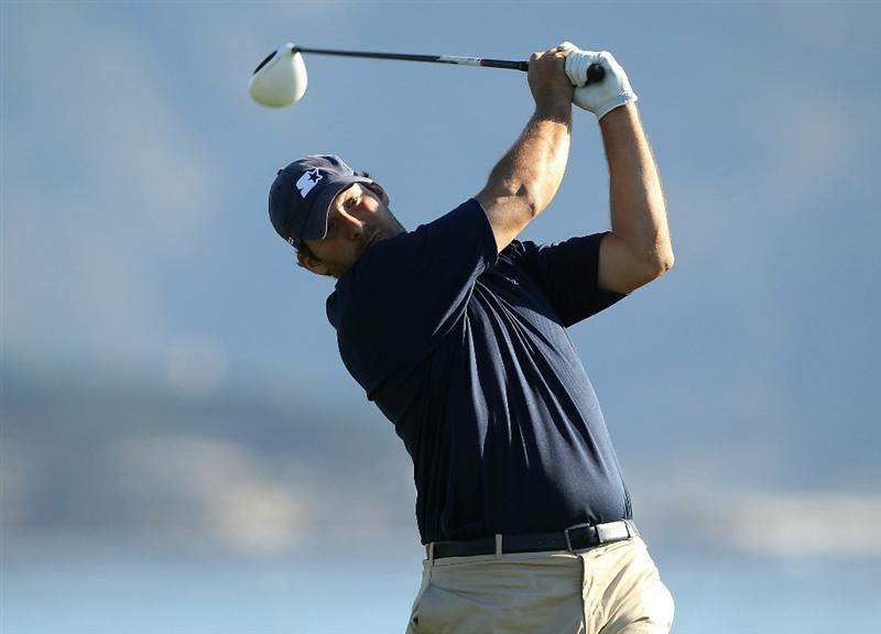 PEBBLE BEACH, CA - FEBRUARY 12:  Professional football player Tony Romo tees off on the 18th hole during the third round of the AT&T Pebble Beach National Pro-Am at the Pebble Beach Golf Links on February 12, 2011 in Pebble Beach, California.  (Photo by Ezra Shaw/Getty Images)