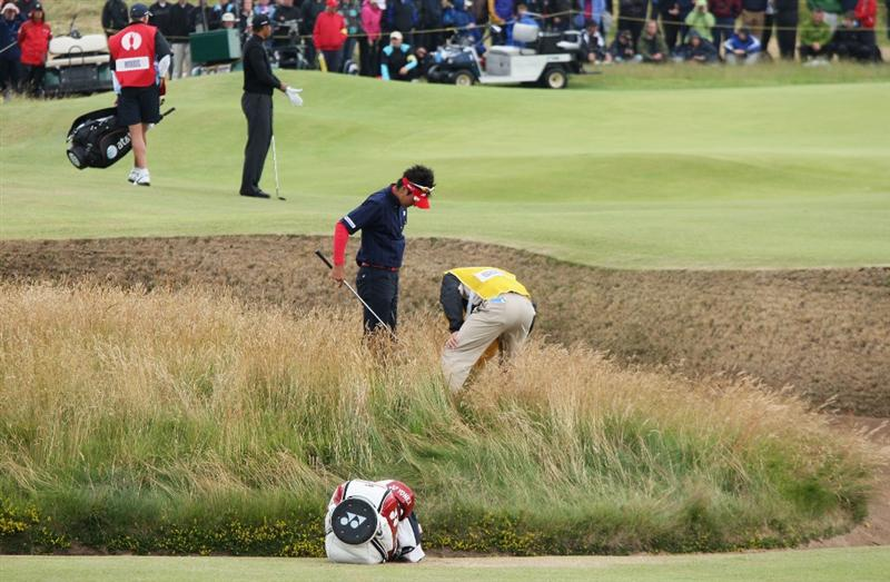 TURNBERRY, SCOTLAND - JULY 17:  Ryo Ishikawa of Japan searches for his ball in the rough during round two of the 138th Open Championship on the Ailsa Course, Turnberry Golf Club on July 17, 2009 in Turnberry, Scotland.  (Photo by David Cannon/Getty Images)