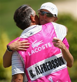 EVIAN, FRANCE - JULY 25:  Helen Alfredsson of Sweden celebrates with her caddie after holing a birdie putt on the 18th hole during the second round of the Evian Masters at the Evian Masters Golf Club on July 25, 2008 in Evian, France.  (Photo by Andrew Redington/Getty Images)