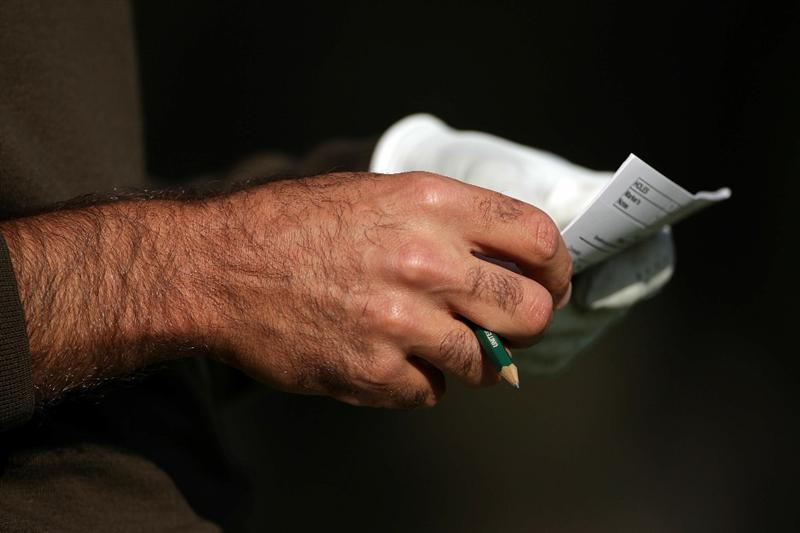 PEBBLE BEACH, CA - JUNE 19:  Gregory Havret looks at his scorecard during the third round of the 110th U.S. Open at Pebble Beach Golf Links on June 19, 2010 in Pebble Beach, California.  (Photo by Andrew Redington/Getty Images)