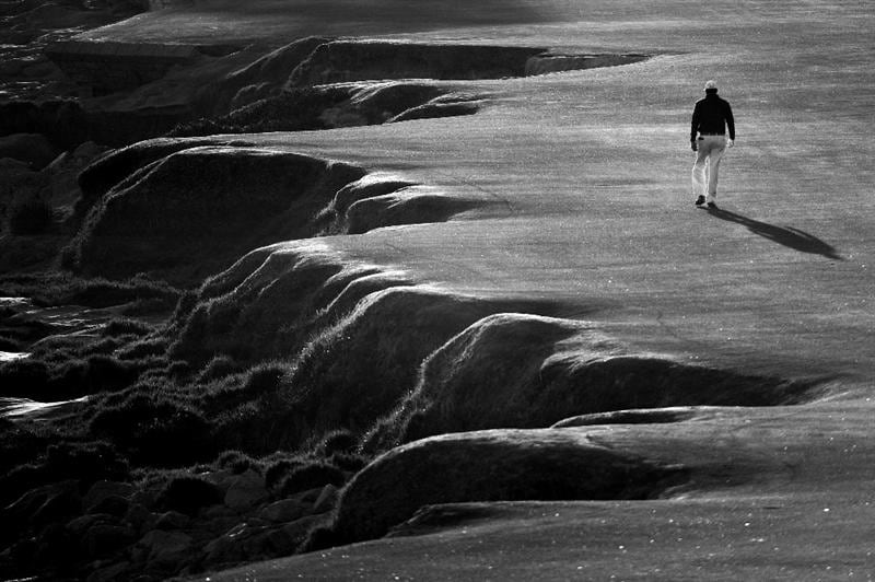 PEBBLE BEACH, CA - JUNE 19: (EDITORS NOTE: IMAGE TRANSMITTED IN BLACK AND WHITE)  Phil Mickelson walks up the 18th fairway during the third round of the 110th U.S. Open at Pebble Beach Golf Links on June 19, 2010 in Pebble Beach, California.  (Photo by Harry How/Getty Images)