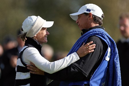 HALMSTAD, SWEDEN - SEPTEMBER 15:  Catriona Matthew (L) of Scotland and the European Team is greeted by Terry MacNamara, the caddy of Annika Sorenstam, after Matthew made a putt to win the final match of the morning foursome matches of the 2007 Solheim Cup the Halmstad Golf Club September 15, 2007 in Halmstad, Sweden.  (Photo by Andy Lyons/Getty Images)