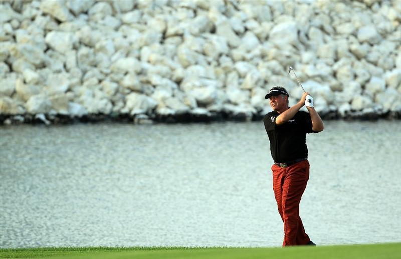 BAHRAIN, BAHRAIN - JANUARY 30:  Darren Clarke of Nortehrn Ireland plays his second shot at the 18th hole during the final round of the 2011 Volvo Champions held at the Royal Golf Club on January 30, 2011 in Bahrain, Bahrain.  (Photo by David Cannon/Getty Images)