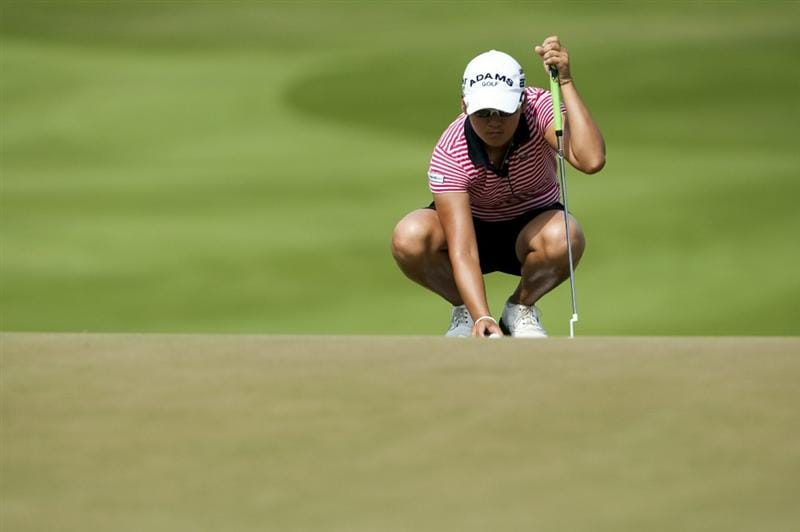 CHON BURI, THAILAND - FEBRUARY 20:  Yani Tseng of Taiwan lines up a putt on the 1st green during day four of the LPGA Thailand at Siam Country Club on February 20, 2011 in Chon Buri, Thailand.  (Photo by Victor Fraile/Getty Images)