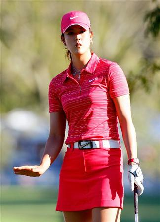 GUADALAJARA, MEXICO - NOVEMBER 15:  Michelle Wie of the United States uses hand signals to slow her chip onto the 17th green during the final round of the Lorena Ochoa Invitational Presented by Banamex and Corona at Guadalajara Country Club on November 15, 2009 in Guadalajara, Mexico.  (Photo by Kevin C. Cox/Getty Images)