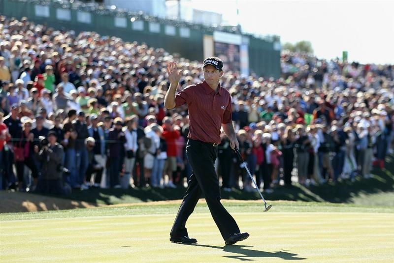SCOTTSDALE, AZ - FEBRUARY 07:  Mark Wilson waves to the crowd on the 18th hole green before going to a playoff against Jason Dufner (not pictured) in the Waste Management Phoenix Open at TPC Scottsdale on February 7, 2011 in Scottsdale, Arizona.  (Photo by Christian Petersen/Getty Images)