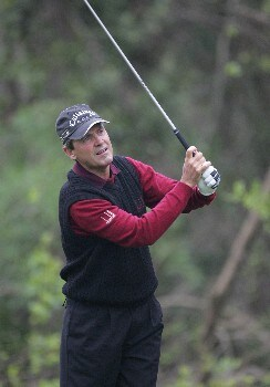 Mark McNulty competes in the rain delayed first round of the Champions Tour Outback Steakhouse Pro-Am at the TPC at Tampa Bay in Lutz, FL