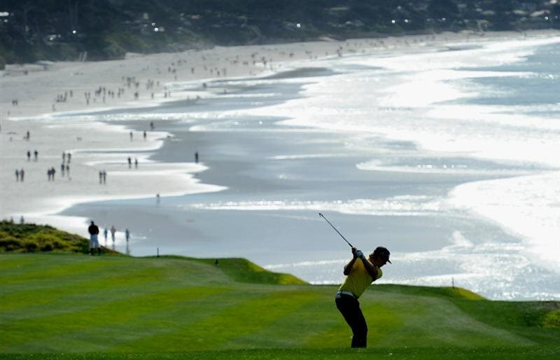 PEBBLE BEACH, CA - FEBRUARY 13:  Hunter Mahan plays his approach shot on the nineth hole during the final round of the AT&T Pebble Beach National Pro-Am at Pebble Beach Golf Links on February 13, 2011  in Pebble Beach, California.  (Photo by Stuart Franklin/Getty Images)