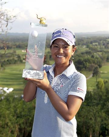 CHON BURI, THAILAND - FEBRUARY 21:  Ai Miyazato of Japan poses with the trophy after winning the final round of the Honda PTT LPGA Thailand at Siam Country Club on February 21, 2010 in Chon Buri, Thailand.  (Photo by Pool/Getty Images)