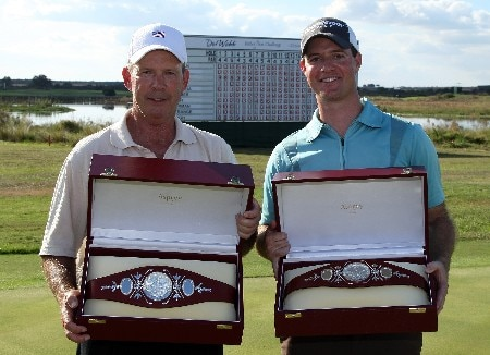 CHAMPIONS GATE, FLORIDA - DECEMBER 02:  Larry Nelson (L) and his son Josh Nelson pose with their trophies after they won the 2007 Del Webb Father Son Challenge on the International Course at Champions Gate Golf Club, on December 2, 2007 in Champions Gate, Florida,  (Photo by David Cannon/Getty Images)