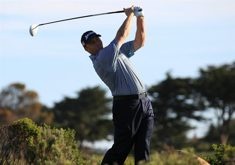 PEBBLE BEACH, CA - FEBRUARY 12:  John Rollins tees off from the 10th hole at the AT&T Pebble Beach National Pro-Am- Round Three at the Monterey Peninsula country club on February 12, 2011 in Pebble Beach, California.  (Photo by Jed Jacobsohn/Getty Images)