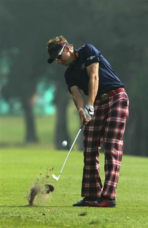 HONG KONG - NOVEMBER 19: Ian Poulter of England plays a shot on the 7th hole during day two of the UBS Hong Kong Open at The Hong Kong Golf Club on November 19, 2010 in Hong Kong, Hong Kong.  (Photo by Stanley Chou/Getty Images)