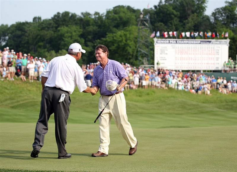 LOUISVILLE, KY - MAY 29:  Tom Watson is congratulated by David Eger after Watson won the Senior PGA Championship presented by KitchenAid in a one hole playoff at Valhalla Golf Club on May 29, 2011 in Louisville, Kentucky.  (Photo by Andy Lyons/Getty Images)