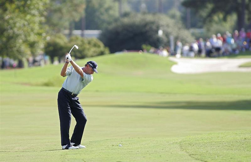 CARY, NC - SEPTEMBER 27:  Nick Price hits his second shot on the 17th hole during the final round of the SAS Championship at Prestonwood Country Club held on September 27, 2009 in Cary,  North Carolina.  (Photo by Michael Cohen/Getty Images)