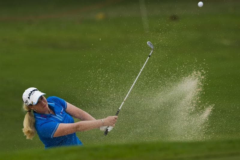 CHON BURI, THAILAND - FEBRUARY 19:  Brittany Lincicome of USA hits out of the bunker on the 10th hole during round two of the Honda LPGA Thailand at the Siam Country Club on February 19, 2010 in Chon Buri, Thailand.  (Photo by Victor Fraile/Getty Images)