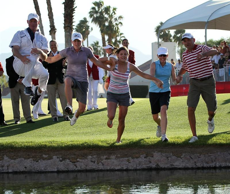 RANCHO MIRAGE, CA - APRIL 03:  Stacy Lewis (second from left), caddie Travis Wilson (L), sister Janet Lewis (C), mother Carol Lewis (second from right) and father Dale Lewis take the traditional jump into the pond after Lewis won the Kraft Nabisco Championship during the final round at Mission Hills Country Club on April 3, 2011 in Rancho Mirage, California.  (Photo by Stephen Dunn/Getty Images)
