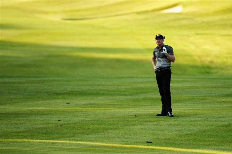 VIRGINIA WATER, ENGLAND - MAY 20:  Jamie Donaldson of Wales prepares to play an iron shot in the 18th fairway during the first round of the BMW PGA Championship on the West Course at Wentworth on May 20, 2010 in Virginia Water, England.  (Photo by Ross Kinnaird/Getty Images)