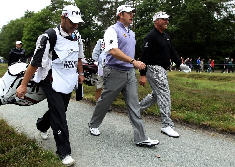 VIRGINIA WATER, ENGLAND - MAY 28:  Darren Clarke of Northern Ireland walks with Lee Westwood (L) of England on the 17th hole during the third round of the BMW PGA Championship at the Wentworth Club on May 28, 2011 in Virginia Water, England.  (Photo by Warren Little/Getty Images)