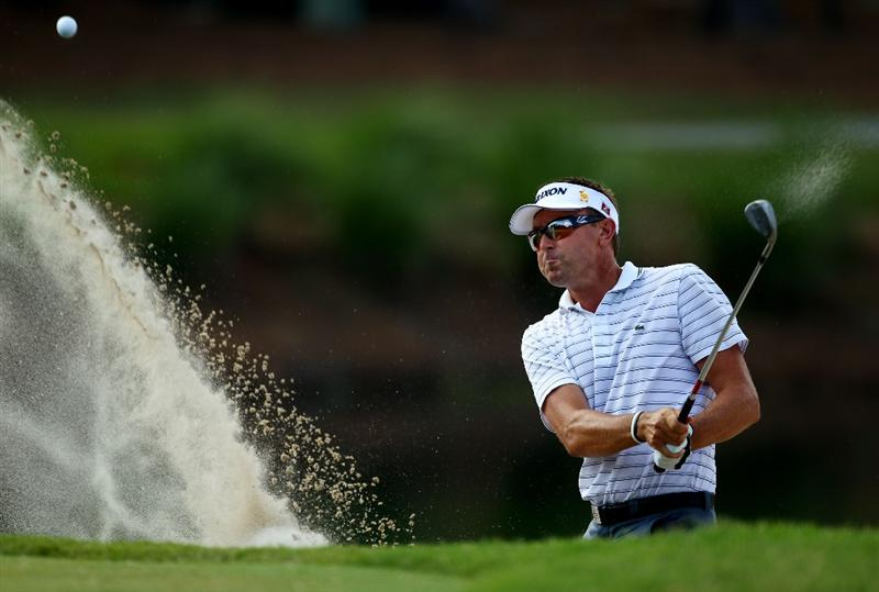 PONTE VEDRA BEACH, FL - MAY 08:  Robert Allenby of Australia plays from a bunker on the 11th hole during the third round of THE PLAYERS Championship held at THE PLAYERS Stadium course at TPC Sawgrass on May 8, 2010 in Ponte Vedra Beach, Florida.  (Photo by Richard Heathcote/Getty Images)