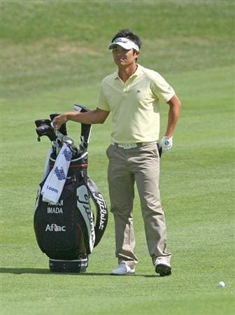 NORTON, MA - SEPTEMBER 6:  Ryuji Imada waits to make his approach shot during the third round of the Deutsche Bank Championship held at TPC Boston on September 6, 2009 in Norton, Massachusetts. (Photo by Jim Rogash/Getty Images)