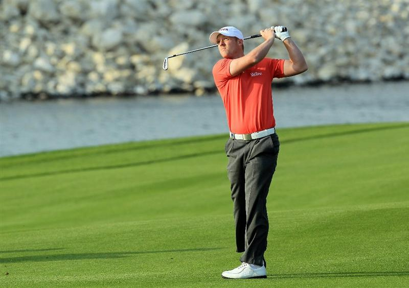 BAHRAIN, BAHRAIN - JANUARY 30:  David Horsey of England plays his second shot at the 18th hole during the final round of the 2011 Volvo Champions held at the Royal Golf Club on January 30, 2011 in Bahrain, Bahrain.  (Photo by David Cannon/Getty Images)