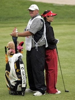 CLIFTON, NJ - MAY 18:  Soo-Yun Kang of South Korea stands behind her caddie, who blocks the wind for her, before hitting her second shot on the 9th hole during the second round of the LPGA Sybase Classic at Upper Montclair Country Club on May 18, 2007 in Clifton, New Jersey.  (Photo by Hunter Martin/Getty Images)