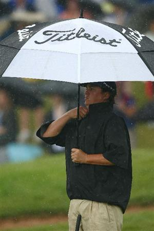 OAKVILLE, ONTARIO, CANADA - JULY 25: Jason Dufner puts on his rain gear on the 18th green during round two of the RBC Canadian Open at Glen Abbey Golf Club on July 25, 2009 in Oakville, Ontario, Canada.  (Photo by Chris McGrath/Getty Images)