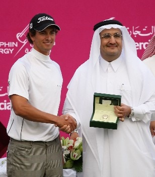 DOHA, QATAR - JANUARY 27:  Adam Scott of Australia is presented with a Rolex watch after the final round of the Commercialbank Qatar Masters held at the Doha Golf Club on January 27, 2008 in Doha,Qatar.  (Photo by Ross Kinnaird/Getty Images)
