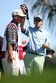 PALM BEACH GARDENS, FL - FEBRUARY 28:  Brett Quigley (R) pulls a club from his bag on the 10th hole during the first round at the Honda Classic at PGA National Resort and Spa February 28, 2008 in Palm Beach Gardens, Florida.  (Photo by Marc Serota/Getty Images)