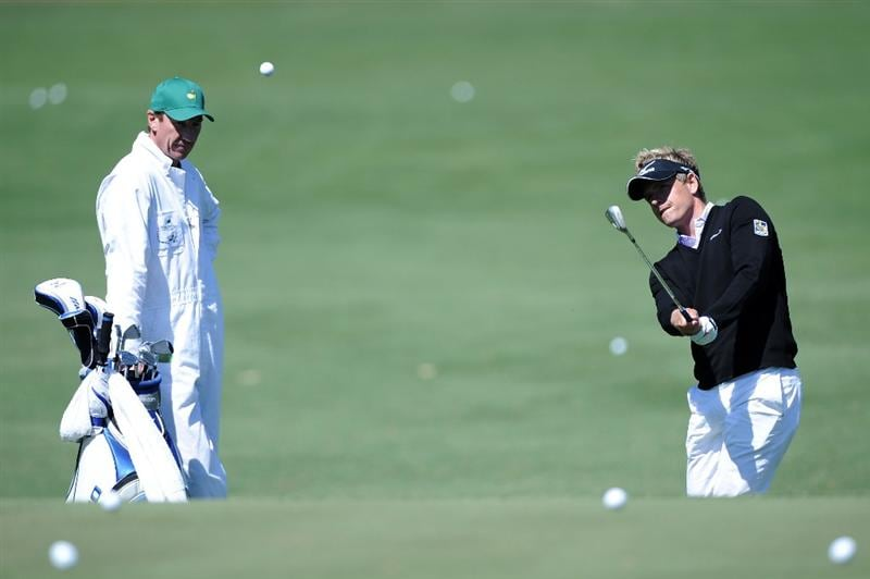 AUGUSTA, GA - APRIL 05:  Luke Donald of England hits a shot on the practice ground alongside his caddie John McLaren during a practice round prior to the 2011 Masters Tournament at Augusta National Golf Club on April 5, 2011 in Augusta, Georgia.  (Photo by Harry How/Getty Images)