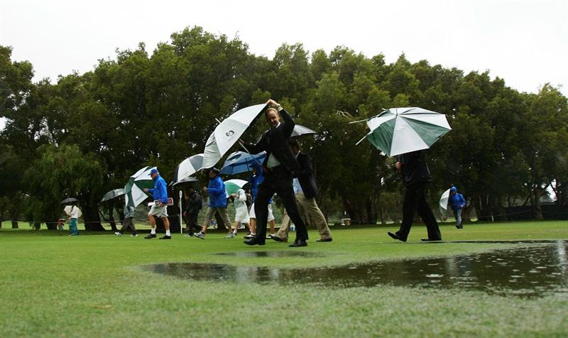 SYDNEY, AUSTRALIA - DECEMBER 12: Spectators walk up the 18th fairway after play was halted due to bad weather during the second round of the 2008 Australian Open at The Royal Sydney Golf Club on December 12, 2008 in Sydney, Australia.  (Photo by Mark Nolan/Getty Images)