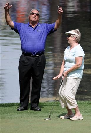 AUGUSTA, GA - APRIL 07:  Fuzzy Zoeller clowns around with a patron on the ninth green during the Par 3 Contest prior to the 2010 Masters Tournament at Augusta National Golf Club on April 7, 2010 in Augusta, Georgia.  (Photo by Harry How/Getty Images)