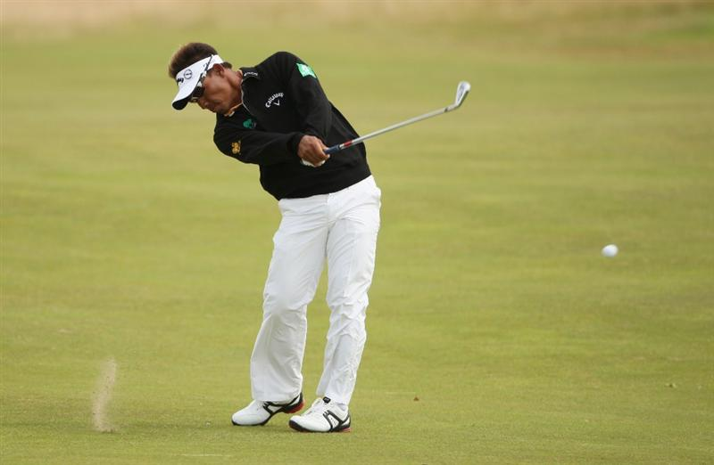 TURNBERRY, SCOTLAND - JULY 18:  Thongchai Jaidee of Thailand hits his second shot on the 14th hole during round three of the 138th Open Championship on the Ailsa Course, Turnberry Golf Club on July 18, 2009 in Turnberry, Scotland.  (Photo by Andrew Redington/Getty Images)