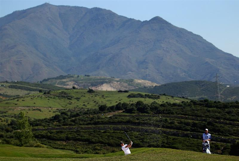 CASARES, SPAIN - MAY 22:  Luke Donald of England plays out of the ninth fairway bunker during the semi final of the Volvo World Match Play Championship at Finca Cortesin on May 22, 2011 in Casares, Spain.  (Photo by Warren Little/Getty Images)
