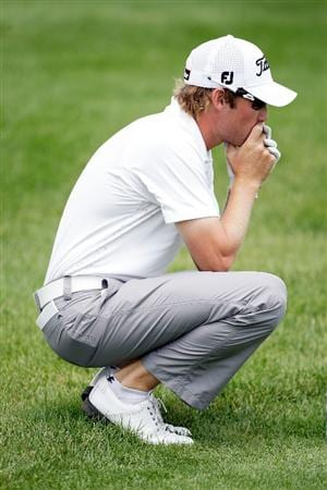 OVERLAND PARK, KS - AUGUST 21:  Michael Sim of Australia prepares to hit his third shot on the 9th hole during the second round of the Nationwide Christmas in October Classic on August 21, 2009 at Lions Gate Golf Club in Overland Park, Kansas.  (Photo by Jamie Squire/Getty Images)