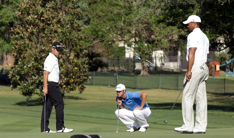 ORLANDO, FL - MARCH 24: Tiger Woods of the USA (right), Dustin Johnson of the USA (centre) and Gary Woodland of the USA (left) on the 15th green during the first round of the 2011 Arnold Palmer Invitational presented by Mastercard at the Bay Hill Lodge and Country Club on March 24, 2011 in Orlando, Florida.  (Photo by David Cannon/Getty Images)