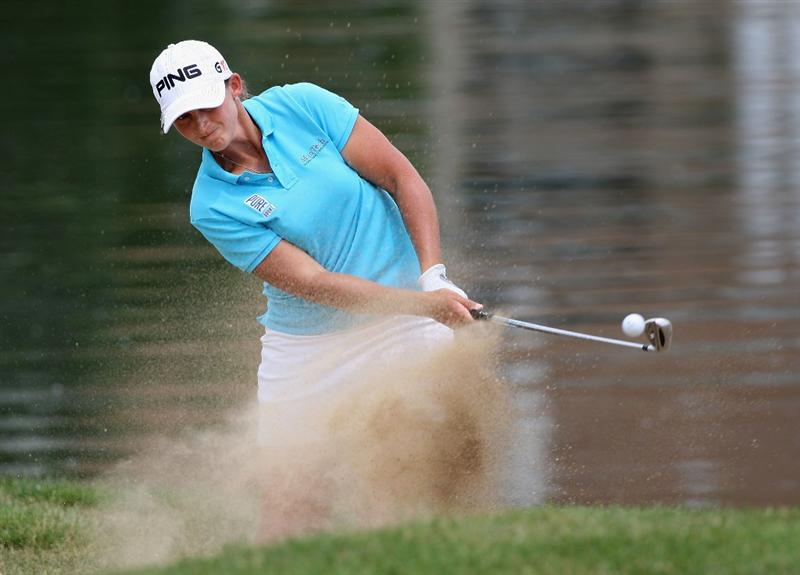 SPRINGFIELD, IL - JUNE 07:  Angela Stanford chips out of the bunker onto the 11th hole green during the fourth round of the LPGA State Farm Classic golf tournament at Panther Creek Country Club on June 7, 2009 in Springfield, Illinois.  (Photo by Christian Petersen/Getty Images)
