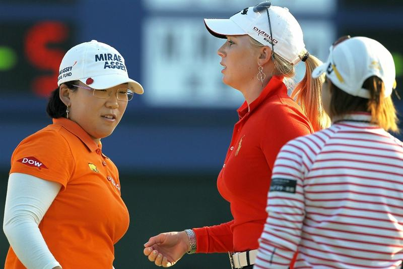 SHIMA, JAPAN - NOVEMBER 06:  (L-R) Shin Ji-yai of South Korea, Morgan Pressel of the United States and Yukari Baba of Japan praise one another after playing on the 18th hole during round two of the Mizuno Classic at Kintetsu Kashikojima Country Club on November 6, 2010 in Shima, Mie, Japan.  (Photo by Kiyoshi Ota/Getty Images)