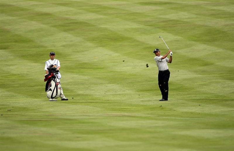 SUNNINGDALE, ENGLAND - JULY 23:  Katsuyoshi Tomori of Japan plays his second shot on the 16th hole during the first round of The Senior Open Championship presented by MasterCard held on the Old Course at Sunningdale Golf Club on July 23, 2009 in Sunningdale, England.  (Photo by Andrew Redington/Getty Images)