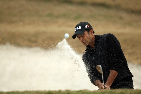 DELHI, INDIA - FEBRUARY 5: Arjun Atwal of India plays from the sand at the 12th hole during the Challenge Match, in the Emaar-MGF Indian Masters at the Delhi Golf Club on February 5, 2008 in Delhi, India.  (Photo by David Cannon/Getty Images)