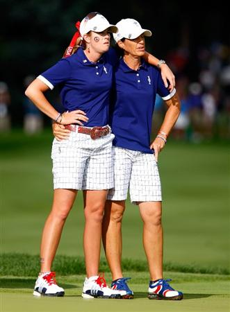 SUGAR GROVE, IL - AUGUST 22:  Paula Creamer and Juli Inkster of the U.S. Team wait on the 15th green during the saturday afternoon foursomes matches at the 2009 Solheim Cup at Rich Harvest Farms on August 22, 2009 in Sugar Grove, Illinois.  (Photo by Scott Halleran/Getty Images)