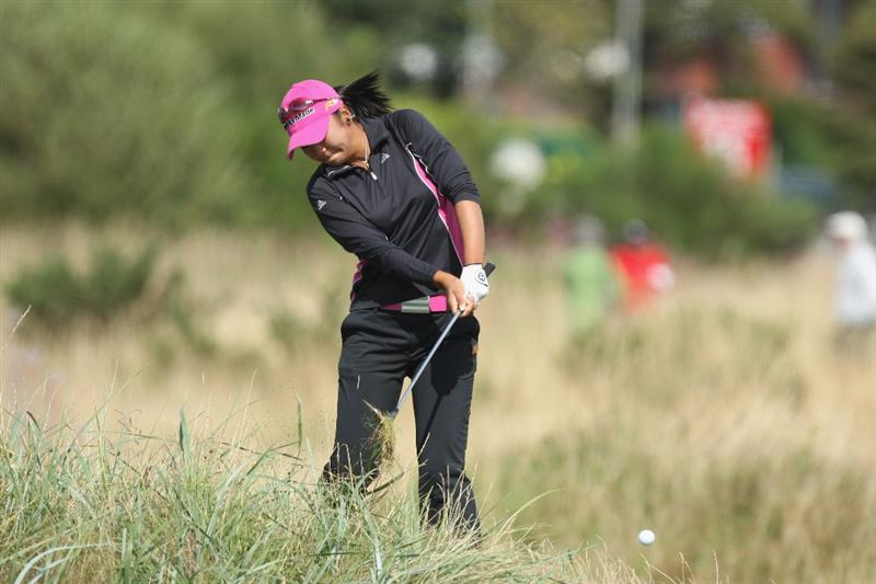 LYTHAM ST ANNES, ENGLAND - AUGUST 01:  Yuko Mitsuka of Japan hits out of the rough on the 15th hole during the third round of the 2009 Ricoh Women's British Open Championship held at Royal Lytham St Annes Golf Club, on August 1, 2009 in Lytham St Annes, England.  (Photo by David Cannon/Getty Images)