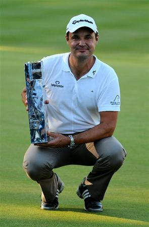 VIRGINIA WATER, ENGLAND - MAY 23:  Simon Khan of England poses with the trophy following his victory at the end of the final round of the BMW PGA Championship on the West Course at Wentworth on May 23, 2010 in Virginia Water, England.  (Photo by Richard Heathcote/Getty Images)