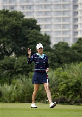 HAIKOU, CHINA - OCTOBER 31:  Lorena Ochoa of Mexico acknowleges spectators during day five of the Mission Hills Start Trophy tournament at Mission Hills Resort on October 31, 2010 in Haikou, China. The Mission Hills Star Trophy is Asia's leading leisure liflestyle event which features Hollywood celebrities and international golf stars.  (Photo by Athit Perawongmetha/Getty Images for Mission Hills)