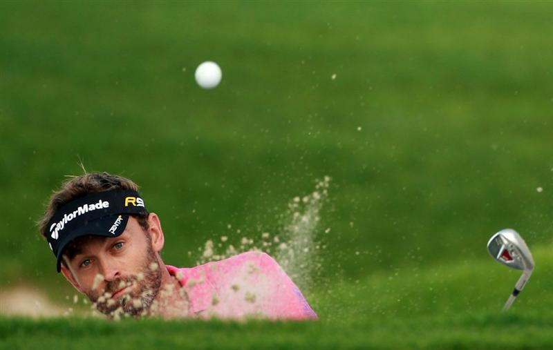 BAHRAIN, BAHRAIN - JANUARY 28:  Raphael Jacquelin of France plays a bunker shot on the ninth hole during the second round of the Volvo Golf Champions at The Royal Golf Club on January 28, 2011 in Bahrain, Bahrain.  (Photo by Andrew Redington/Getty Images)