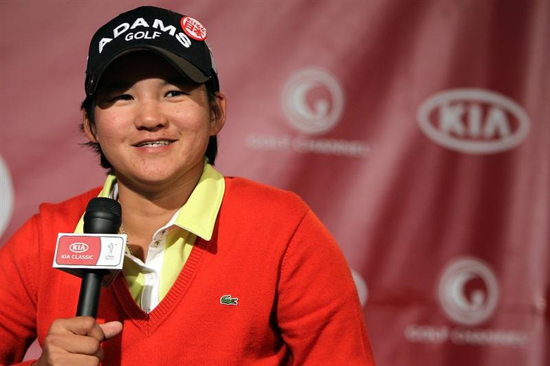 CITY OF INDUSTRY, CA - MARCH 22:  Yani Tseng of Taiwan wears a pin to promote raising funds through First Giving/Never Give Up Japan for the Japanese earthquake and tsunami during a press conference before the start of the LPGA Kia Classic on March 22, 2011 at the Industry Hills Golf Club in the City of Industry, California.  (Photo by Scott Halleran/Getty Images)