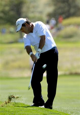 PARKER, CO. - MAY 30: David Frost of South Africa hits his approach shot into the 18th hole during the fourth and final round of the Senior PGA Championship at the Colorado Golf Club on May 30, 2010 in Parker, Colorado.  (Photo by Marc Feldman/Getty Images)