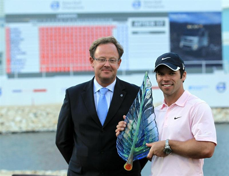BAHRAIN, BAHRAIN - JANUARY 30:  Paul Casey of England holds the trophy with Per Ericsson The CEO of Volvo Event Management after the final round of the 2011 Volvo Champions held at the Royal Golf Club on January 30, 2011 in Bahrain, Bahrain.  (Photo by David Cannon/Getty Images)